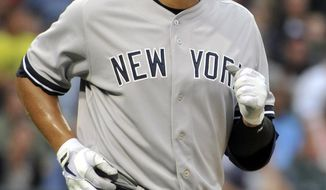 New York Yankees' Alex Rodriguez jogs to first base after getting a walk against the Chicago White Sox during the first inning of a baseball game, Tuesday, Aug. 6, 2013 in Chicago. (AP Photo/David Banks)