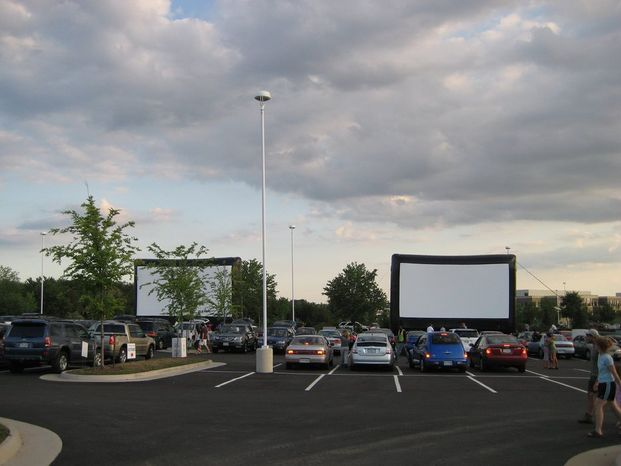 Comcast Outdoor Film Festival moviegoers watch films on a 3-story high screen. Movie fans attending this year's festival can see three films over three nights Aug. 16-18. Proceeds support the National Institutes of Health charities that aid children with serious illnesses.