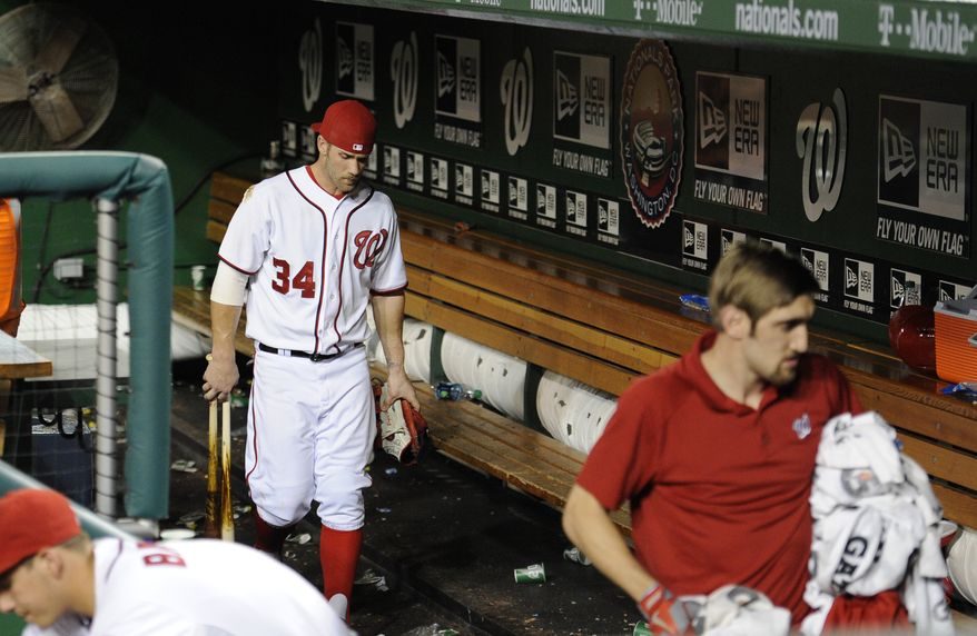 Washington Nationals outfielder Bryce Harper walks through the dugout after his team was swept by the Atlanta Braves Wednesday night. (Associated Press photo)