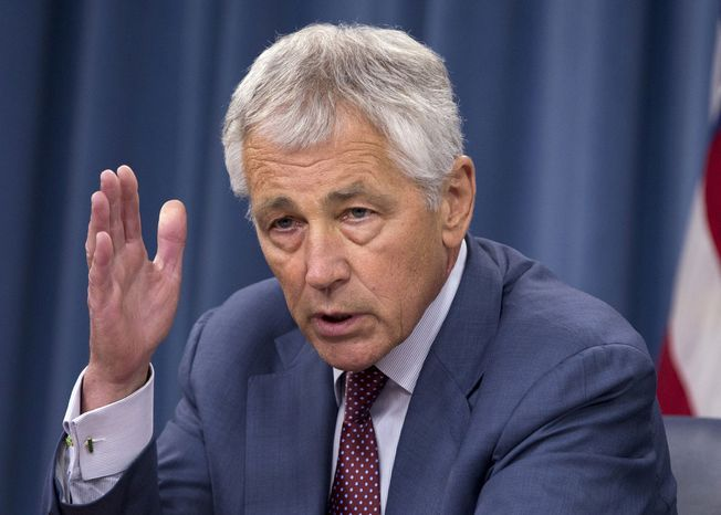 ** FILE **Defense Secretary Chuck Hagel speaks during a news conference at the Pentagon, July 31, 2013. (AP Photo/Evan Vucci, File)