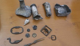 Items unearthed in Lower Manhattan are on display during a news conference, Wednesday, Aug. 7, 2013, in New York. (AP Photo/Mary Altaffer)