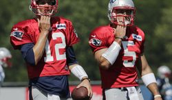New England Patriots quarterbacks Tom Brady, left, and Tim Tebow during a team NFL football practice in Foxborough, Mass., Tuesday, July 30, 2013.(AP Photo/Charles Krupa)