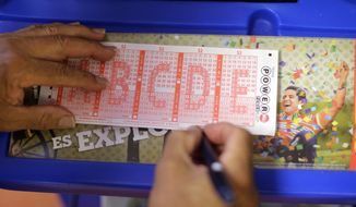 ** FILE ** A Powerball lottery form is filled out, Wednesday, Aug. 7, 2013, in San Antonio. (AP Photo/Eric Gay)