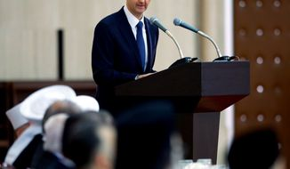 ** FILE ** In this Sunday, Aug. 4, 2013, photo released by the Syrian official news agency SANA, Syrian President Bashar Assad delivers a speech at an Iftar dinner with political and religious figures in Damascus, Syria. (AP Photo/SANA)
