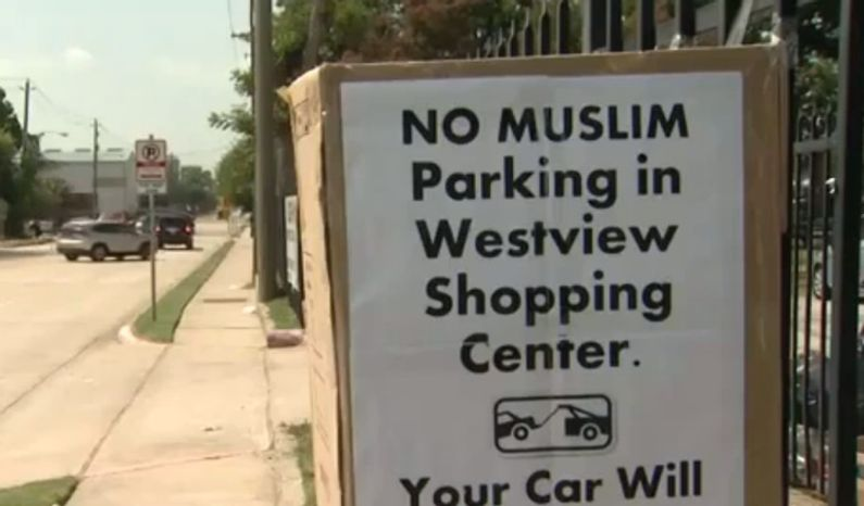 A screen capture is seen here of a sign banning Muslims from using a Houston shopping center's parking lot, one of several which mysteriously appeared at the end of Ramadan. The shopping center is located across the street from a mosque. (Courtesy of KPRC-TV)