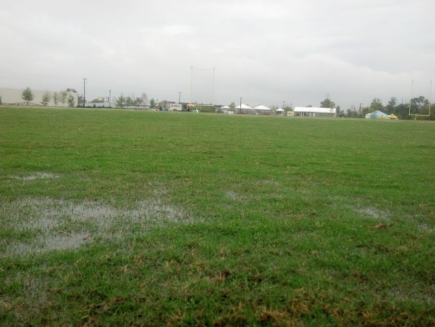 Water stands just outside the end zone of the Redskins' practice field at their training center in Richmond. The team canceled its 2 p.m. practice after a severe thunderstorm soaked the fields from about 1:45 to 2:10. (Rich Campbell / The Washington Times)