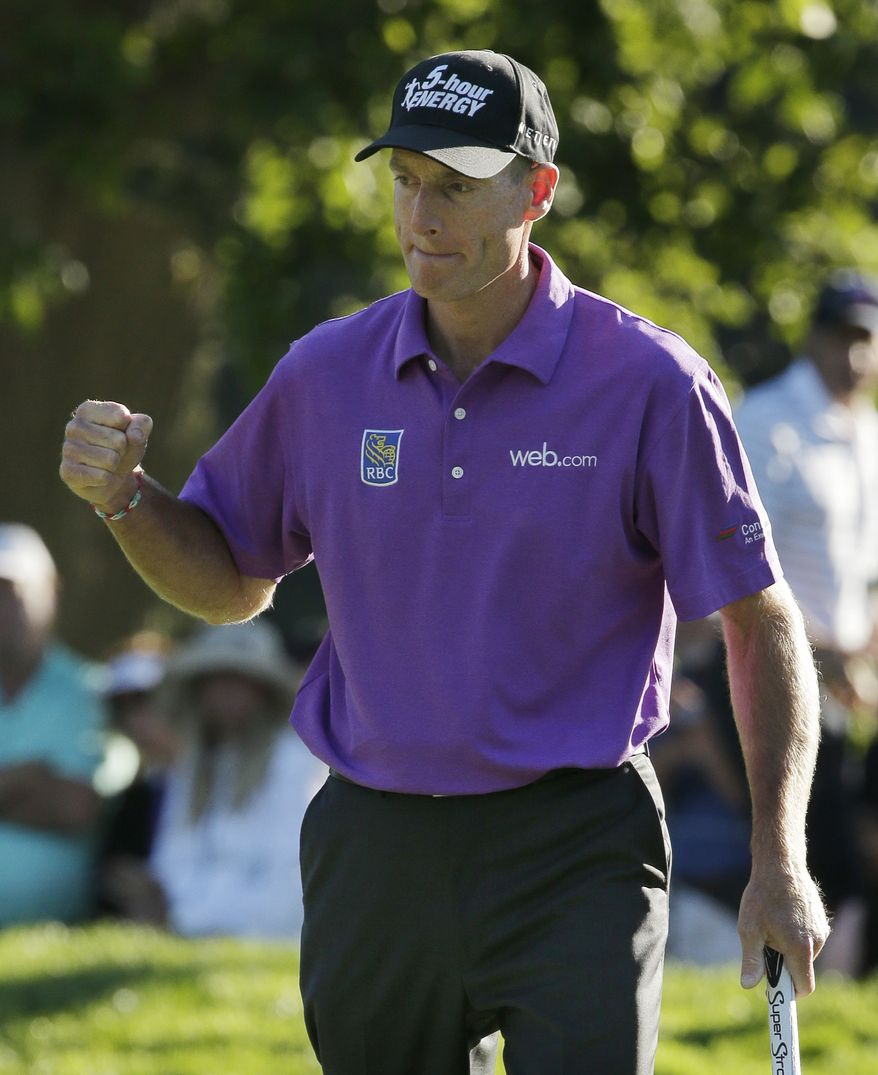 Jim Furyk celebrates after a birdie on the 17th hole during the third round of the PGA Championship golf tournament at Oak Hill Country Club, Saturday, Aug. 10, 2013, in Pittsford, N.Y. (AP Photo/Charlie Riedel)