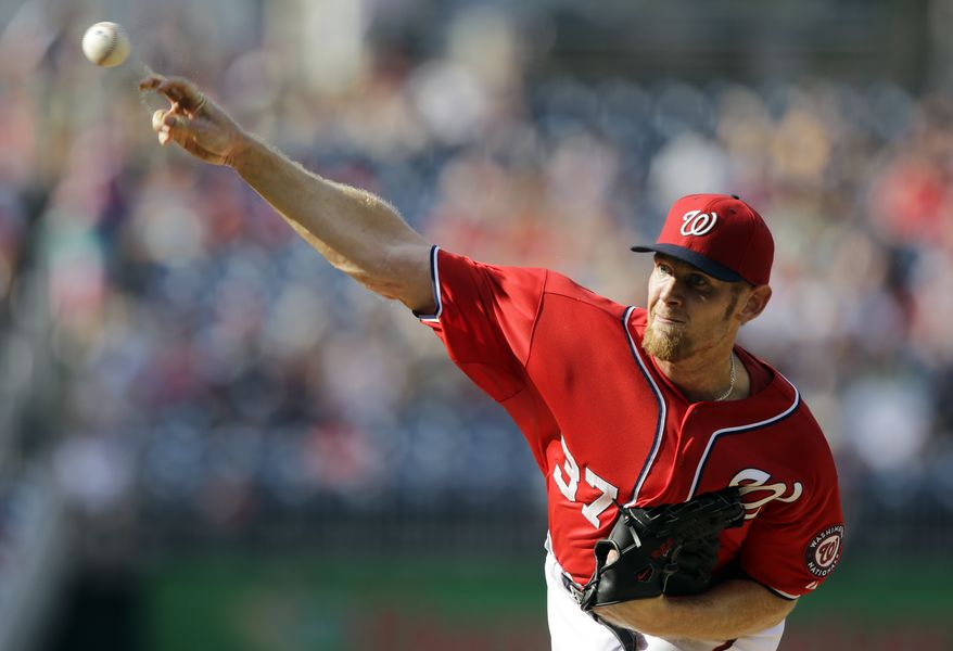 Washington Nationals starting pitcher Stephen Strasburg (37) throws during the first inning of a baseball game against the Philadelphia Phillies at Nationals Park, Sunday, Aug. 11, 2013, in Washington. (AP Photo/Alex Brandon)