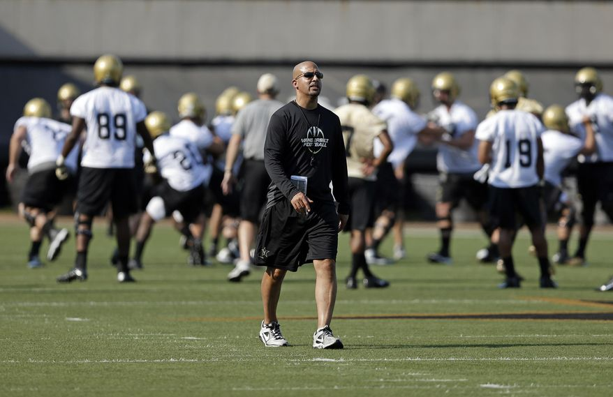 ** FILE ** Vanderbilt head coach James Franklin watches his players during an NCAA college football practice on Thursday, Aug. 1, 2013, in Nashville, Tenn. (AP Photo/Mark Humphrey)