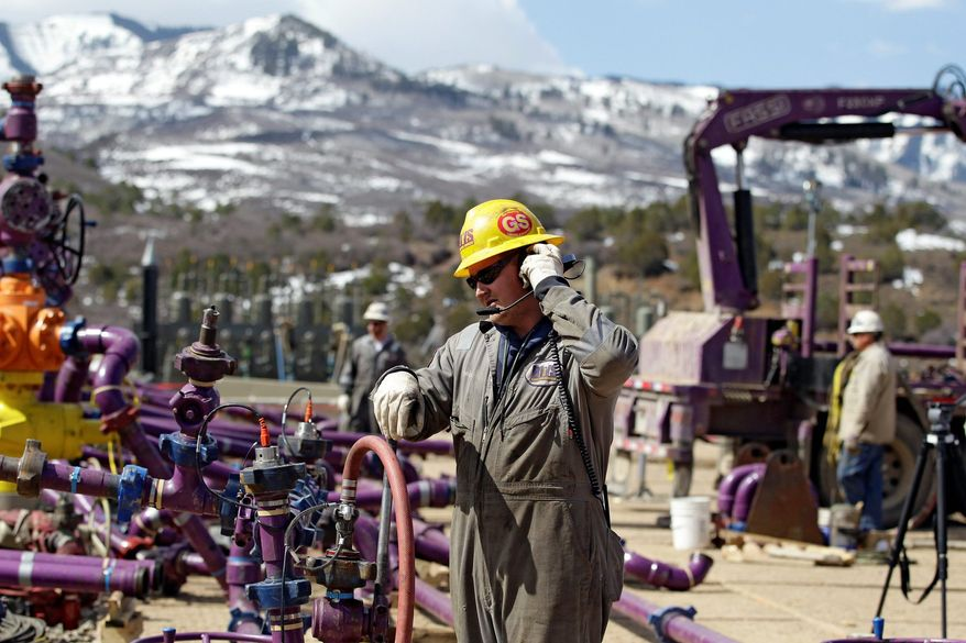 With pump trucks aplenty, workers at hydraulic fracturing sites have been able to extract petroleum and natural gas from subterranean shale. The plentiful and cheap energy has given the U.S. a competitive edge. (Associated Press)