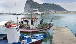 **FILE** Spanish fishing boats sit moored in La Linea de Concepcion, Spain, in front of Gibraltar on May 28, 2012. (Associated Press)