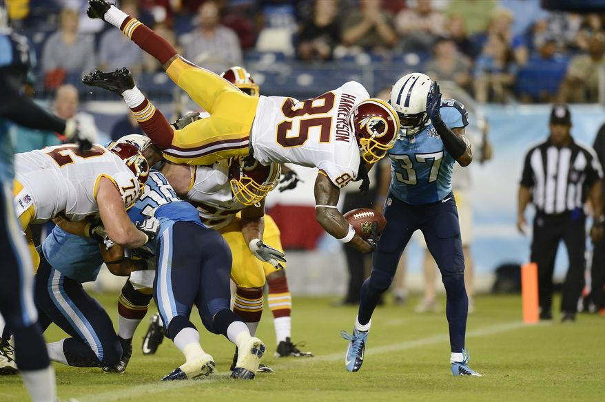 Washington Redskins wide receiver Leonard Hankerson (85) flips into the end zone as he scores a touchdown on an 8-yard pass play against the Tennessee Titans in the second quarter of a preseason NFL football game on Thursday, Aug. 8, 2013, in Nashville, Tenn. Defending for the Titans are Al Afalava (38) and Tommie Campbell (37). (AP Photo/Mark Zaleski)