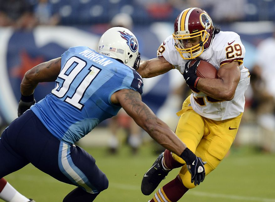 Tennessee Titans defensive end Derrick Morgan (91) closes in on Washington Redskins running back Roy Helu (29) in the first quarter of a preseason NFL football game on Thursday, Aug. 8, 2013, in Nashville, Tenn. (AP Photo/Mark Zaleski)