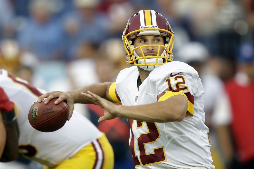 Washington Redskins quarterback Kirk Cousins (12) throws against the Tennessee Titans in the first quarter of a preseason NFL football game on Thursday, Aug. 8, 2013, in Nashville, Tenn. (AP Photo/Wade Payne)