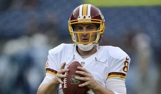 Washington Redskins quarterback Rex Grossman warms up before a preseason NFL football game against the Tennessee Titans on Thursday, Aug. 8, 2013, in Nashville, Tenn. (AP Photo/Mark Zaleski)