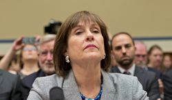 Lois Lerner, head of the Internal Revenue Service unit that decides whether to grant tax-exempt status, was put on administrative leave after she declared her innocence but refused to answer congressional questions about the targeting. (Associated Press)