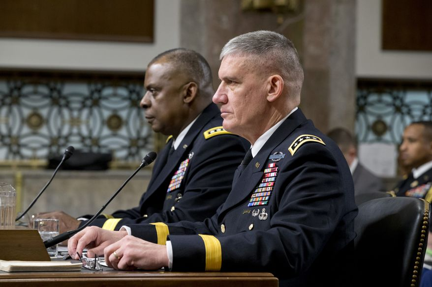 The Senate Armed Services Committee meets on Capitol Hill in Washington on Feb. 14, 2013, to consider the nominations of Gen. Lloyd J. Austin III (left) for reappointment to the grade of general and to be commander of the U.S. Central Command, and Gen. David M. Rodriguez (right) for reappointment to the grade of general and to be commander of the U.S. Africa Command. (Associated Press) **FILE**