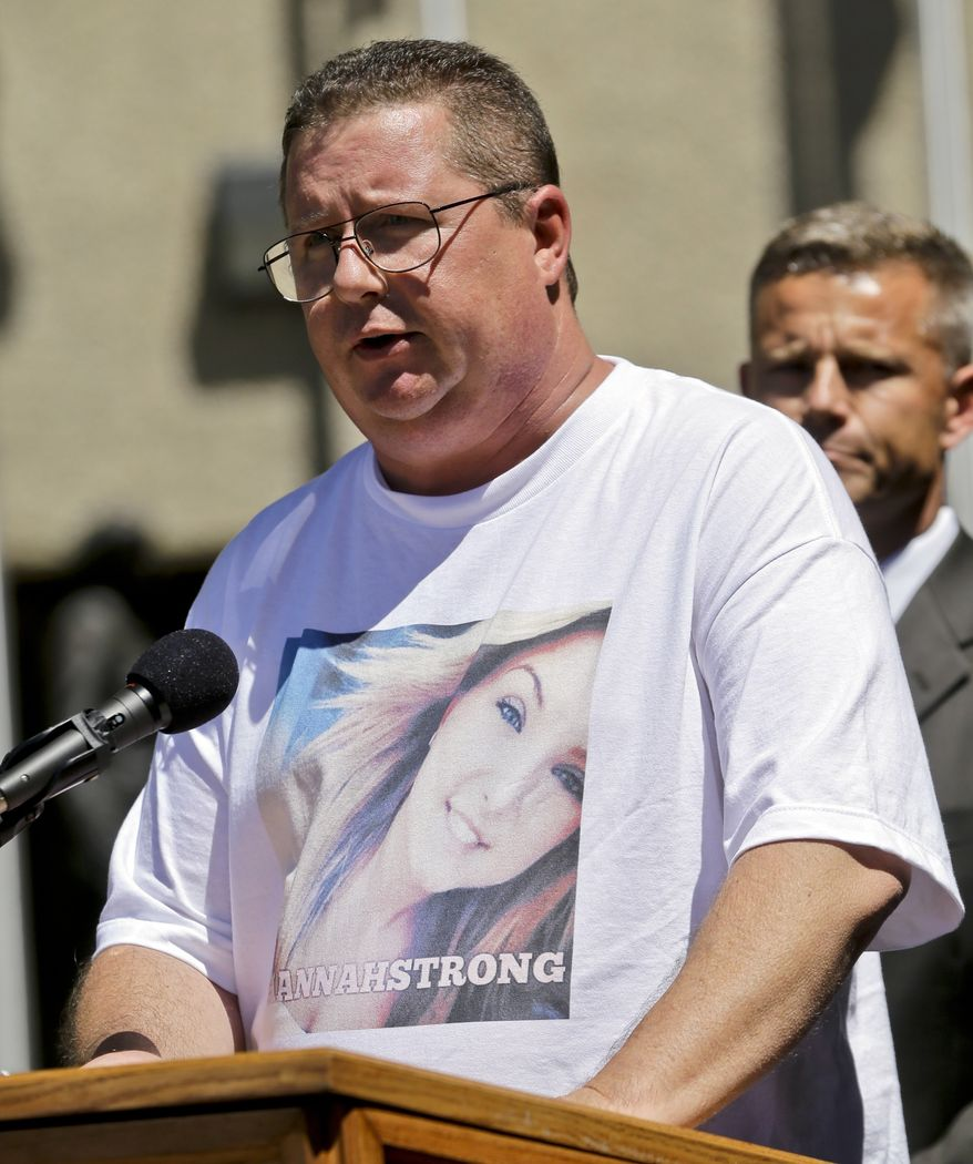 Brett Anderson, wearing a shirt featuring a photo of his daughter, Hannah, makes a statement regarding her kidnapping and rescue at a news conference Monday, Aug. 12, 2013, in San Diego. Anderson is flanked by FBI agent Rob Howe. James Lee DiMaggio, 40, suspected of killing Hannah's mother and brother before fleeing with her in the Idaho wilderness, was killed in a shootout with law enforcement on Saturday. (AP Photo/Lenny Ignelzi)