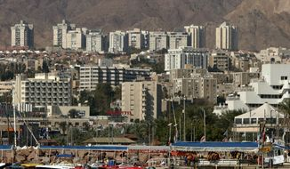 ** FILE ** In this Jan. 30, 2007, file photo, a general view of the Red Sea resort city of Eilat is seen in southern Israel on the border with Egypt. Israel's military said Thursday, Aug. 8, 2013, it has ordered the closure of the airport in the Red Sea resort of Eilat, citing unspecified security reasons. (AP Photo/Ariel Schalit, File)