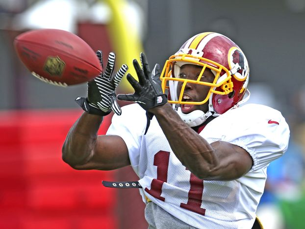 Washington Redskins' Aldrick Robinson catches a pass during afternoon practice at the NFL football team's training camp in Richmond, Va., Tuesday, Aug. 13, 2013. (AP Photo/Richmond Times-Dispatch, P. Kevin Morley)