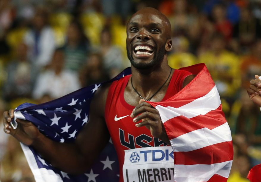 United States' LaShawn Merritt celebrates with his country's flag after winning the gold medal in the men's 400-meter final at the World Athletics Championships in the Luzhniki stadium in Moscow, Russia, Tuesday, Aug. 13, 2013. (AP Photo/Matt Dunham)