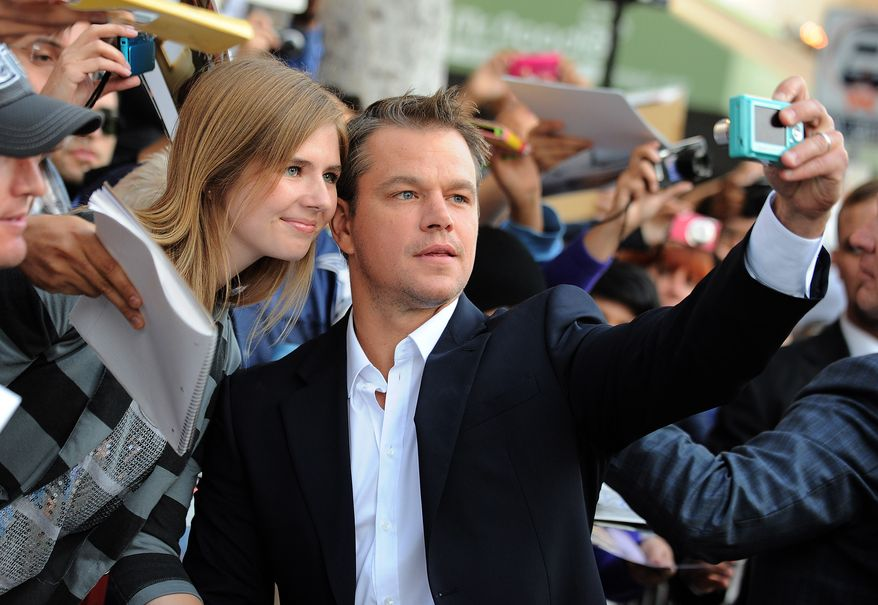 """Actor Matt Damon arrives at the world premiere of """"Elysium"""" in Los Angeles on Wednesday, Aug. 7, 2013. (Photo by Jordan Strauss/Invision/AP)"""