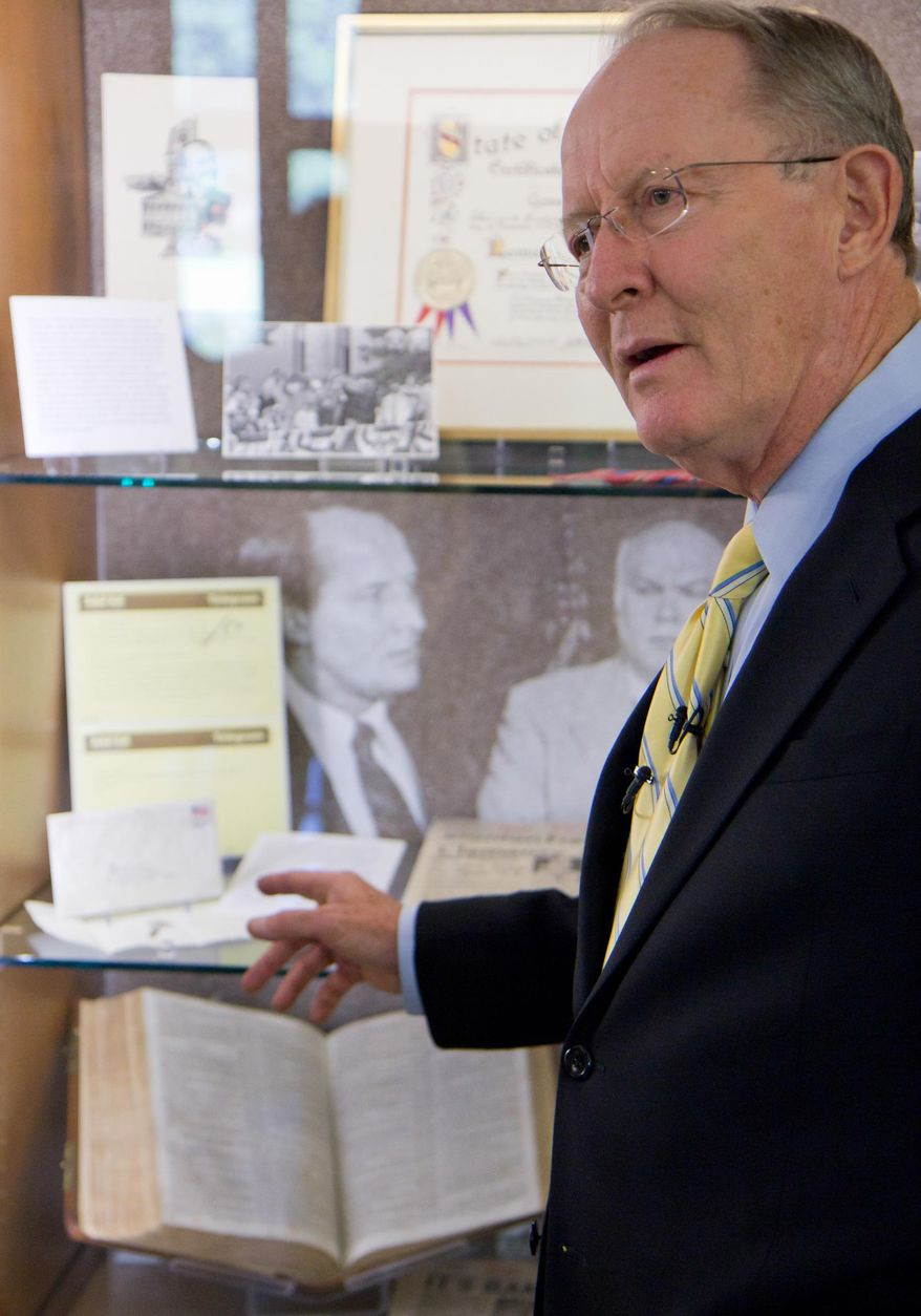 ** FILE ** In this Sept. 16, 2011, file photo, U.S. Sen. Lamar Alexander, R-Tenn., discusses papers and memorabilia on display in an exhibit about his political career at Vanderbilt University in Nashville, Tenn. (AP Photo/Erik Schelzig, file)