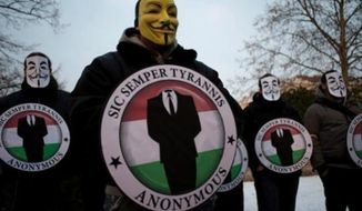 Members of the hacking group Anonymous. (Associated Press)