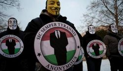 Members of the hacking group Anonymous. (Associated Press) ** FILE **
