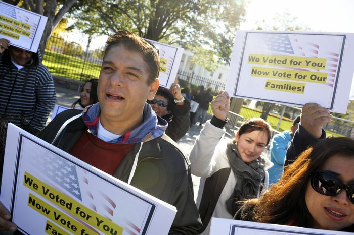 **FILE** Members of immigration rights organizations, including Casa in Action and Maryland Dream Act, demonstrate Nov. 8, 2012, in front of the White House as they call on President Obama to fulfill his promise of passing comprehensive immigration reform. (Associated Press)
