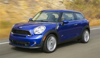 ** FILE ** The BMW Mini Cooper S Paceman ALL4. (Associated Press)