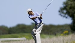 President Barack Obama tees off while golfing at Vineyard Golf Club in Edgartown, Mass., on the island of Martha's Vineyard Wednesday, Aug. 14, 2013. (AP Photo/Steven Senne)