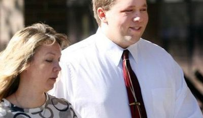 ** FILE ** Roy High School bomb plot suspect Joshua Kyler Hoggan, 16, right, walks out of the 2nd District Juvenile Court in Ogden with his mother, Janice Hoggan, April 4, 2011. (AP Photo/Standard-Examiner, Robert Johnson,File)