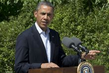 President Obama makes a statement to the media regarding events in Egypt from his rental vacation home in Chilmark Mass., on the island of Martha's Vineyard, on Aug. 15, 2013. The president announced that the U.S. is canceling joint military exercise with Egypt amid violence. (Associated Press)