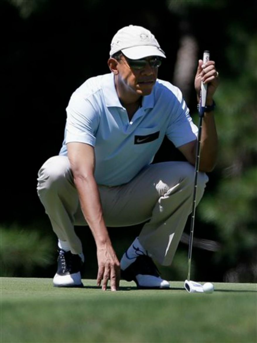 President Obama prepares to putt while golfing at Mink Meadows Golf Club, in Vineyard Haven, Mass., on the island of Martha's Vineyard, Thursday, Aug. 15, 2013. President Obama and his wife Michelle are vacationing on the island. (AP Photo/Steven Senne)