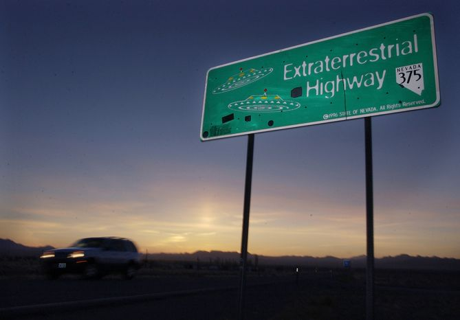 **FILE** A car moves along the Extraterrestrial Highway near Rachel, Nev., on April 10, 2002. The ET highway was established by the Nevada Legislature in 1996 and runs along the eastern border of Area 51, a military base on the Nevada Test Site that the U.S. government has only recently admitted exists. (Associated Press)