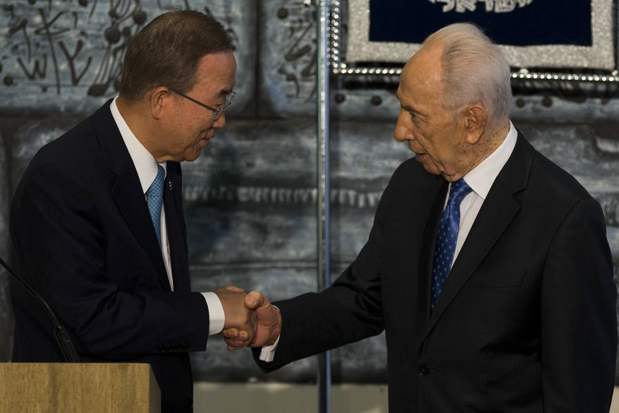 U.N. Secretary-General Ban Ki-moon, left, shakes hands with Israel's President Shimon Peres after a joint press conference in the Presidents residence in Jerusalem, Friday, Aug. 16, 2013. (AP Photo/Bernat Armangue)