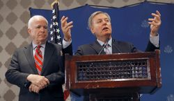 **FILE** U.S. Sens. John McCain (left) and Lindsey Graham talk during a press conference in Cairo on Aug. 6, 2013. (Associated Press)