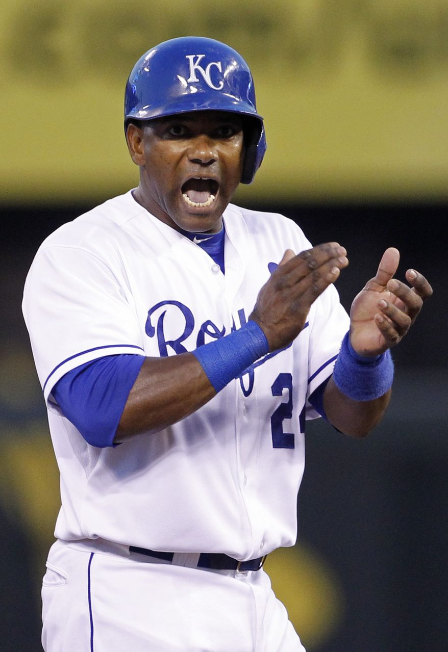 Kansas City Royals' Miguel Tejada reacts after hitting an RBI double in the fifth inning of a baseball game against the Boston Red Sox at Kauffman Stadium in Kansas City, Mo., Saturday, Aug. 10, 2013. (AP Photo/Colin E. Braley)