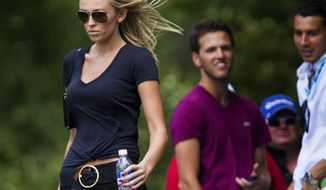 Paulina Gretzky, left, follows her boyfriend Dustin Johnson during the final round of the Canadian Open golf tournament at Glen Abbey Golf Club in Oakville, Ontario, Sunday, July 28, 2013. (AP Photo/The Canadian Press, Aaron Lynett)