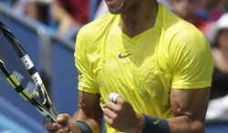 Rafael Nadal, from Spain, reacts after winning the first set against John Isner during the finals match at the Western & Southern Open tennis tournament on Sunday, Aug. 18, 2013, in Mason, Ohio. Nadal won 7-6 (8), 7-6 (3). (AP Photo/Al Behrman)