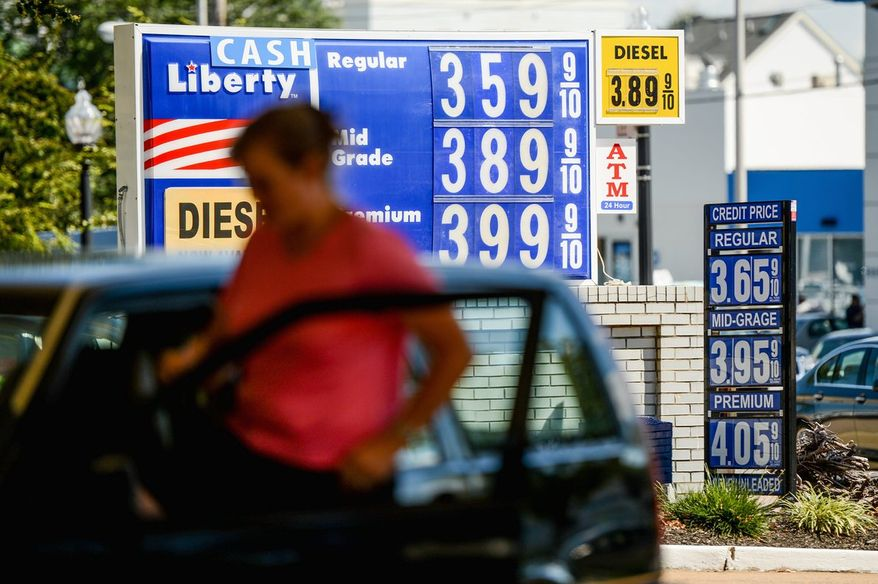The price for a gallon of gas on Lee Highway in Arlington and across Virginia has pushed the state toward the bottom nationally, ranking 45th overall since the gas tax was lowered. (andrew harnik/the washington times)
