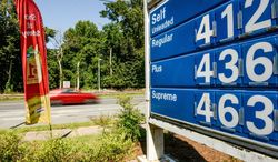 Gasoline prices in Maryland, as displayed at a station on MacArthur Boulevard in Bethesda, are up after the tax was raised. (Andrew Harnik/The Washington Times)