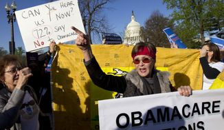 **FILE** Linda Door of Laguna Beach, Calif., protests outside the United States Supreme Court in Washington on March 26, 2012, as the court begins hearing arguments on the constitutionality of President Obama's health care overhaul, the Patient Protection and Affordable Care Act. (Associated Press)
