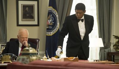 """Robin Williams as Dwight Eisenhower, left, and Forest Whitaker as Cecil Gaines in a scene from """"Lee Daniels' The Butler."""" (AP Photo/The Weinstein Company, Anne Marie Fox)"""