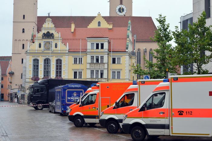 Emergency vehicles sit in front of the Rathaus, or city hall, in Ingolstadt, Germany, on Monday, Aug. 19, 2013, after a man took several hostages. Police spokesman Guenther Beck said it wasn't clear what weapons the man might have or what he wants. The incident started shortly before 9 a.m. (3 a.m. EDT), and Mr. Beck said police were in contact with the man by telephone. (AP Photo/dpa, Peter Kneffel)