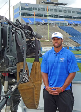 This Monday, Aug. 19, 2013 photo provided by Middle Tennessee State University shows NCAA college football player Steven Rhodes, a defensive end, during an interview in Murfreesboro, Tenn. The NCAA says it's working with Middle Tennessee and hasn't made a final decision