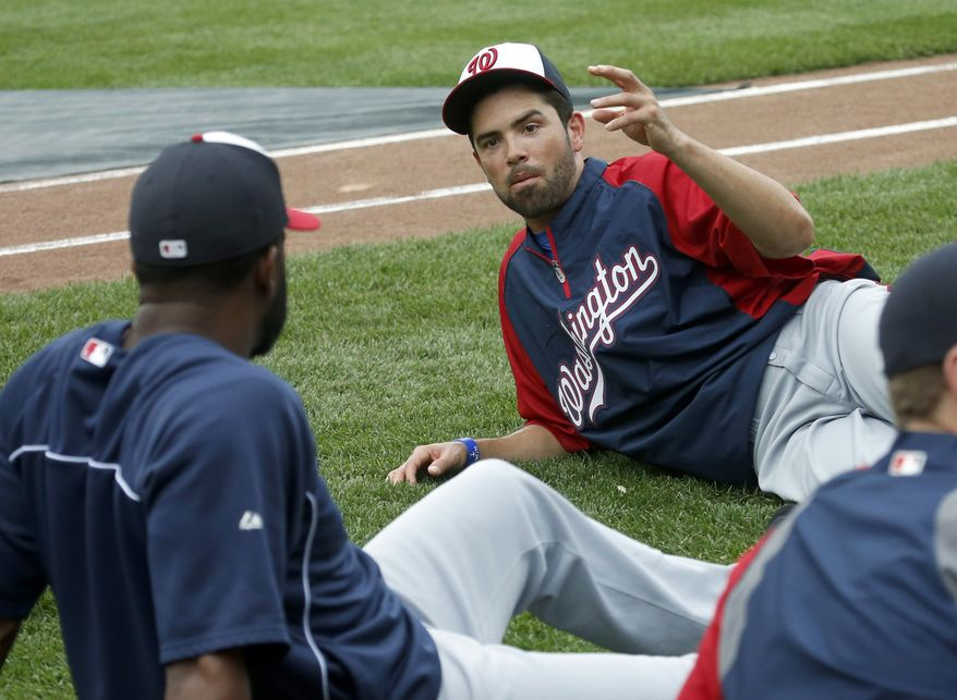 Washington Nationals' David DeJesus, right, talks with new teammate Denard Span after he was traded by the Chicago Cubs to the Nationals before a baseball game between the Cubs and Nationals at Wrigley Field, Monday, Aug. 19, 2013, in Chicago. (AP Photo/Charles Rex Arbogast)