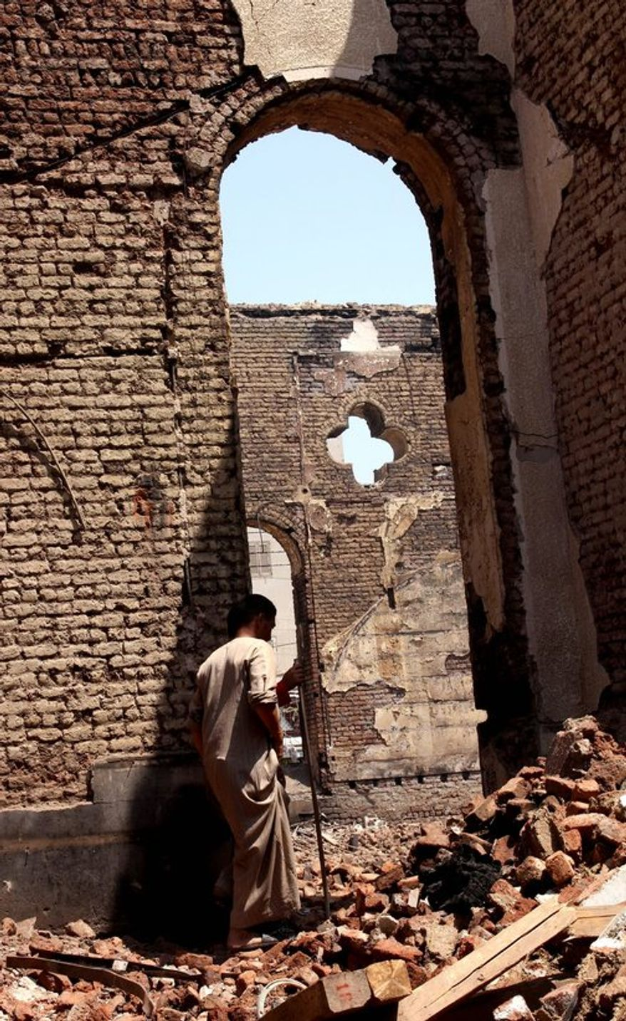 The Evangelical Church of Malawi was ransacked, looted and burned Thursday as supporters of ousted Egyptian President Mohammed Morsi took out their anger at Coptic Christians. (Associated Press)