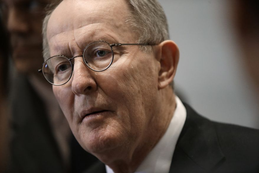 **FILE** Sen. Lamar Alexander, Tennessee Republican, speaks to reporters on Jan. 9, 2013, in Nashville. (Associated Press)